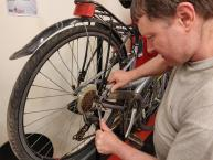 a trainee working on a bike