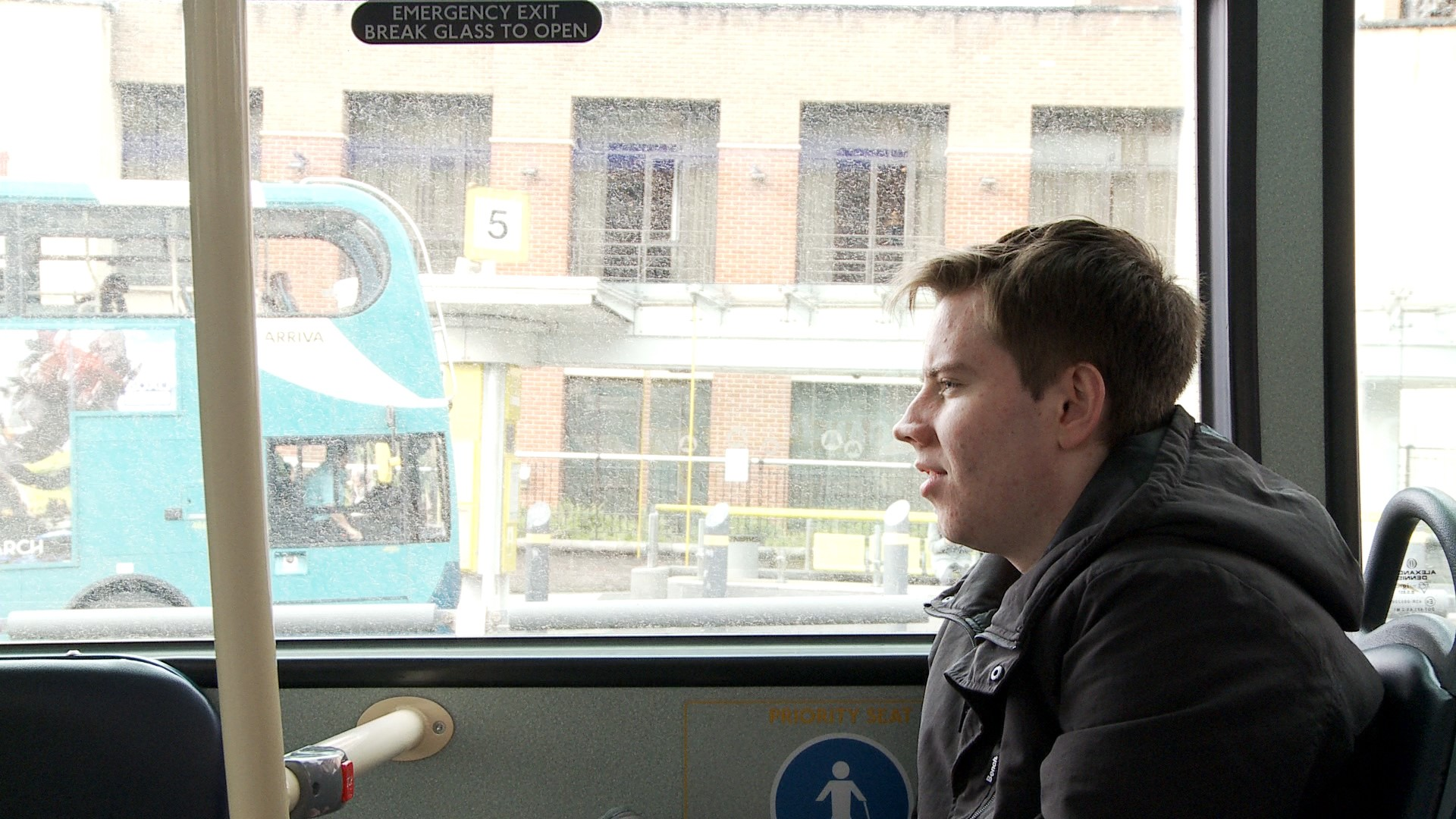 Michael sitting on a bus