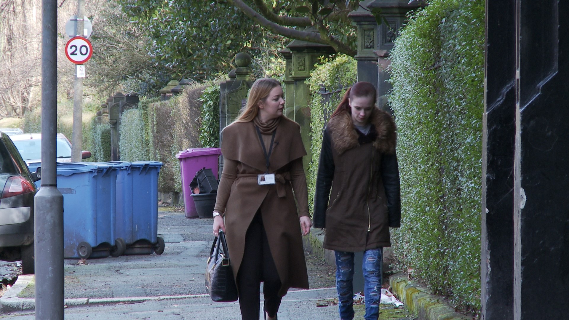 Trainer Emma and Courtney walking in street