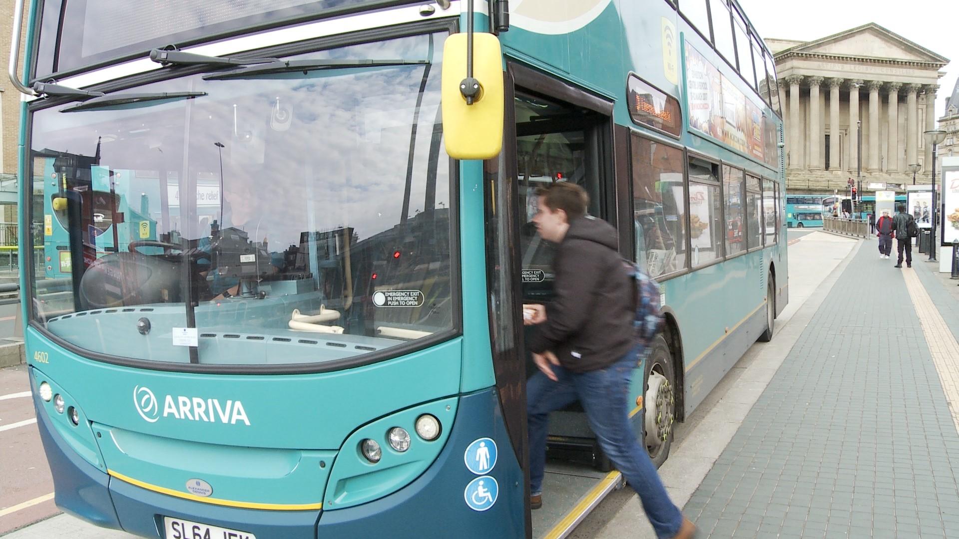 Michael boarding a bus