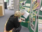 30th Anniversary Exhibition, person checking out the history of GMCDP!