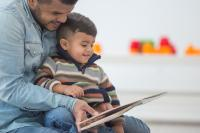 picture of dad with son reading