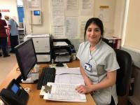 Photo of Sara working at her desk in the hospital