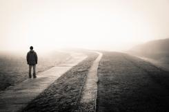 Feel cut off from others, person on long lonely road, feeling different and isolated