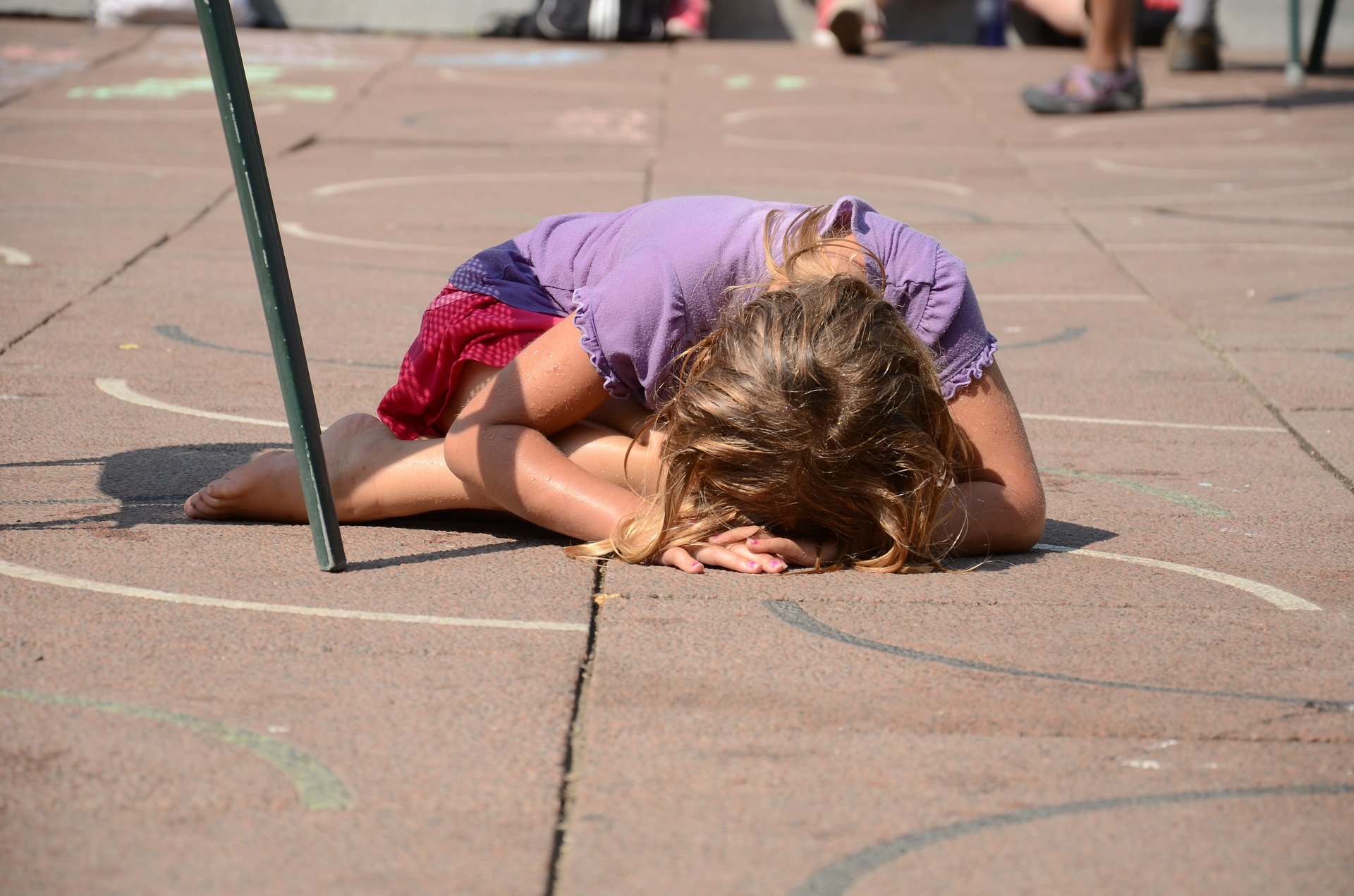 image of girl laying on the floor unhappy