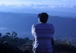Person Sitting Alone looking out over hills