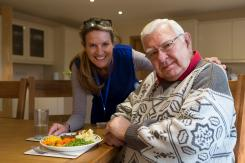 Elderly man receiving meals at home service