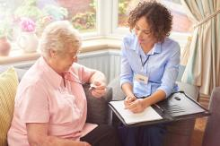 Lady in own home receiving advice about being safe and secure