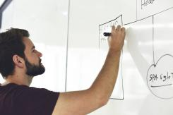 Man using white board