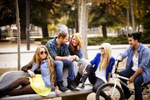 Young people hanging out in the town centre