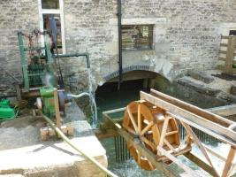 Small water wheel demonstrating how the big wheel operates.