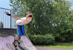 Rollerblading in a skatepark