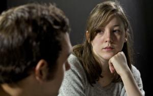 Young woman talking to a practitioner