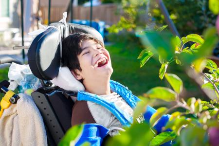 Boy in wheelchair laughing