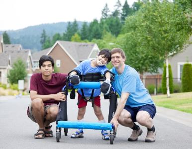 Small boy outdoors with two adults