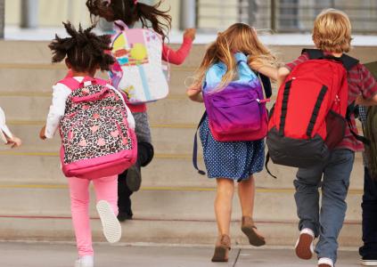 image of children running into school playground