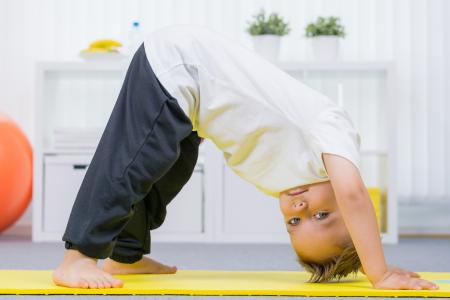 Small child doing exercises
