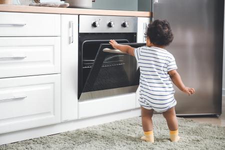 Toddler opening the oven door