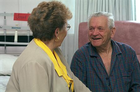 Hospital volunteer talking to patient