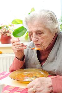 Lady eating soup