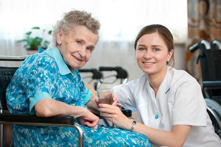 Lady in wheelchair with care assistant