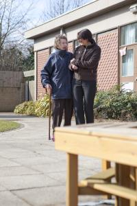 Lady walking with carer