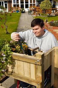 Man gardening at supported living scheme