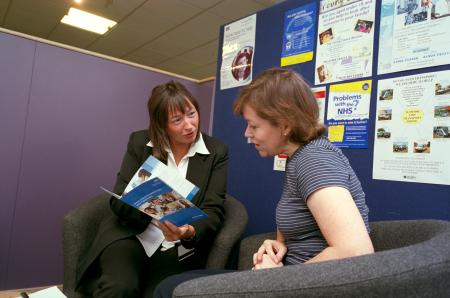 Two ladies reading a leaflet