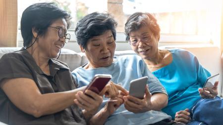 Older ladies looking at mobile phones