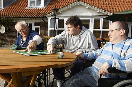 People sat outside a supported living scheme