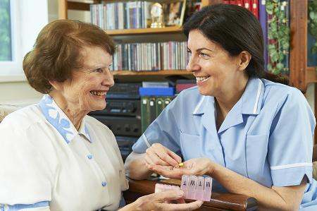 Carer helping with medication