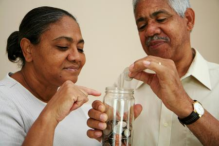 People putting money in a jar