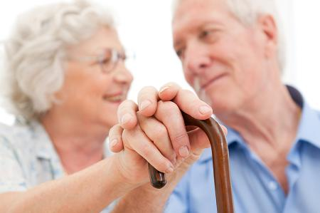 Older couple with walking stick