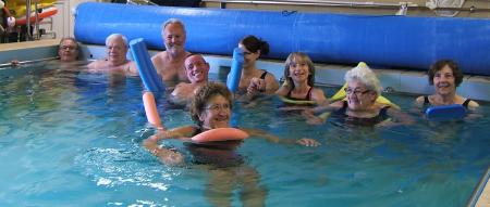 People swimming in the hydrotherapy pool