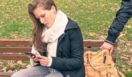 Young woman having her handbag stolen