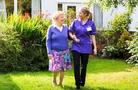 Carer with older lady in garden