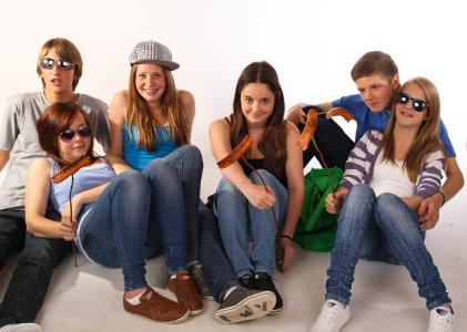Teenagers sitting on the floor