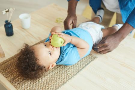 Toddler having nappy changed