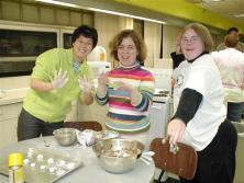 three women baking together