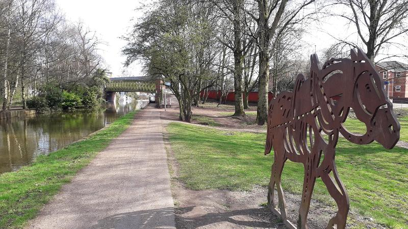 canal path with  iron horse sculpture