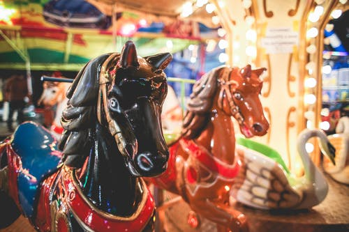 funfair ride with painted horses