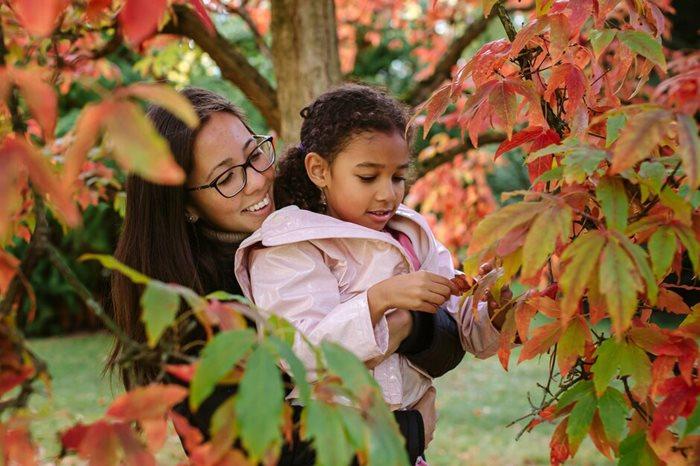 mum and child by autumn tree
