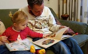 child adult reading together