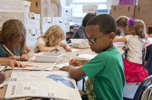 boy in green shirt in classroom
