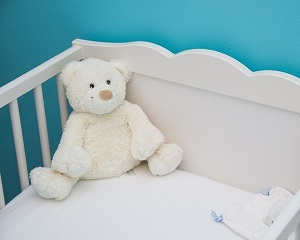 teddy in cot