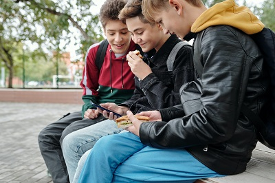 teenage boys with smartphone