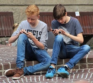 young boys with smartphones