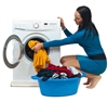 Image of woman putting washing in washing machine