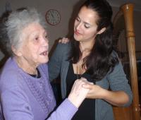 Musician dancing with a resident during a Lost Chord session.