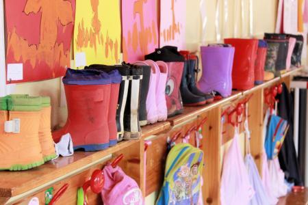 Shelf full of children's wellington boots
